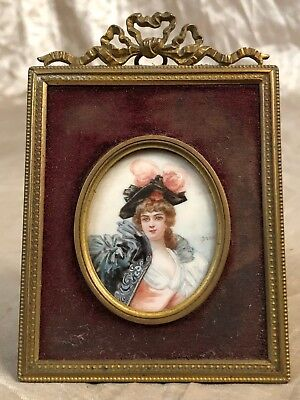 Portrait of 18th century French female, miniature on vellum. Bronze frame
