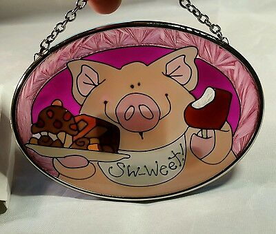 joan baker hand painted stained glass pig with chocolate little suncatcher