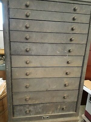 This is a old metal cabinet with 10 drawers Hyannis Mass. Jewelry  shop