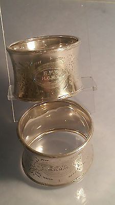 Pair of matching waisted silver napkin rings dated  1929 ornate pattern