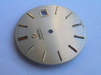 omega 1012 brushed  silver  dial, gold markers size 29.45mm