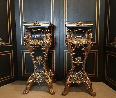 Pair of Louis XV french Black And Gold Pedestal black marble top. Reproduction.