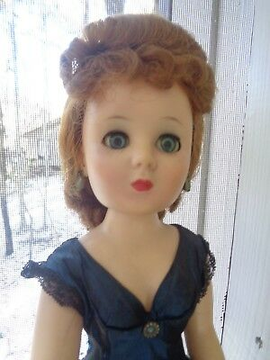 "1957 Sweet Sue Sophisticate 20"", blue dress, fancy chignon hairstyle"