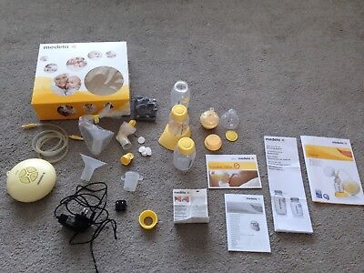 Medela Swing, Single, Electric, Breast Pump, with plenty of spare parts