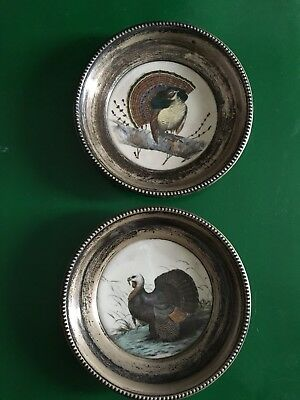 A pair of Frank M. Whiting china and sterling hand painted coasters