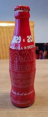 Very nice wrapped Coca cola bottle fom germany full glass bottle 80 years