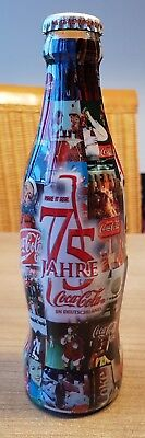 very nice coca cola glass bottle from germany. 75 years.  Full Wrapped bottle