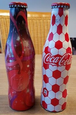 nice coca cola alu bottles from germany. Two Full bottles. Christmas and footbal