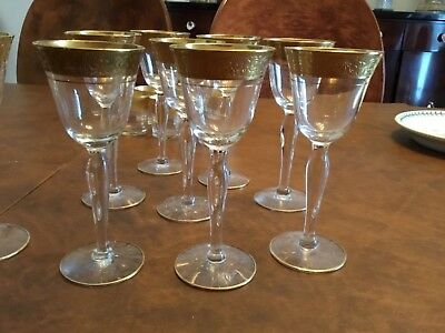 18 tffin gold sherry glasses and  9 shot glasses 9 sherry