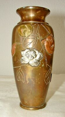 Vintage brass or bronze vase with raised flowers in copper, gold, & silver color