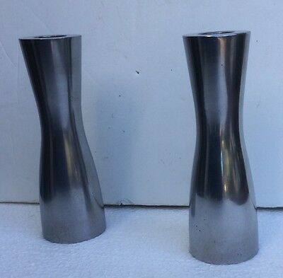 Pair of modern / contemporary cast aluminum candlesticks/ candle holders