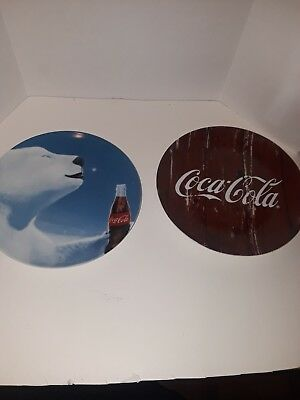 Two coca cola collector plates markings