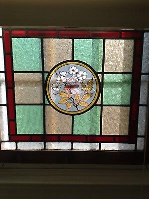 Pair of antique stained glass windows with handpainted birds