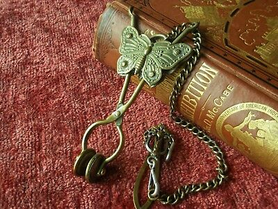 Victorian Brass skirt lifter,belt clip and chatelaine chain.