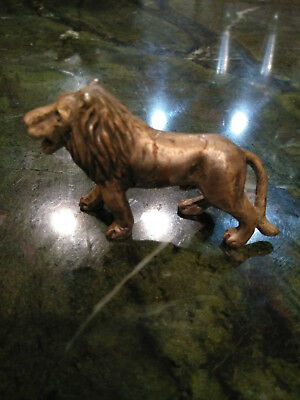 Lion figure stamped pewter