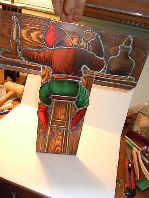 antique hand painted stained glass window / architect sitting  at bench