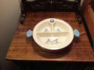 vintage baby dish with blue lambs hot water heated