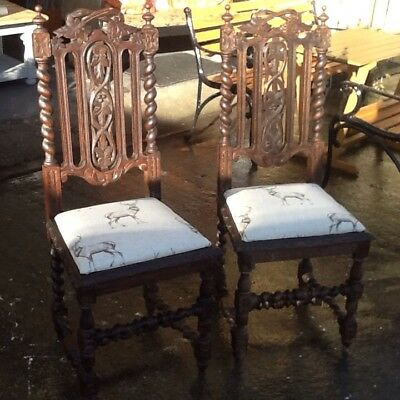 A Beautiful Pair Of Heavily Carved Antique Oak Chairs