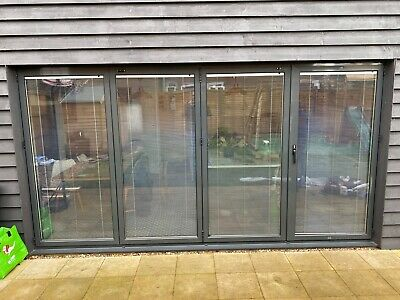 New, Quality Aluminium Bi fold Patio Doors inc Glass 4 panels. WITH BLINDS