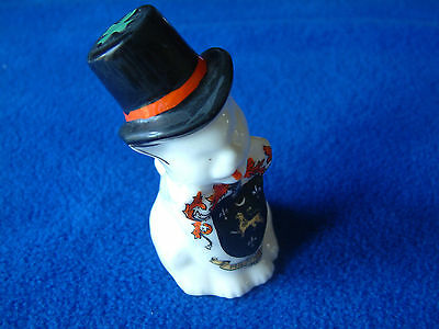 MILDENHALL Carlton crested china sitting cat with black hat and green cross