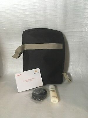 QWSTION Swiss Business Class amenity bag + assorted toiletry items
