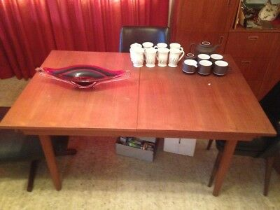 Chiswell teak dining setting & 6 P.E.Kafka dining chairs in as new condition