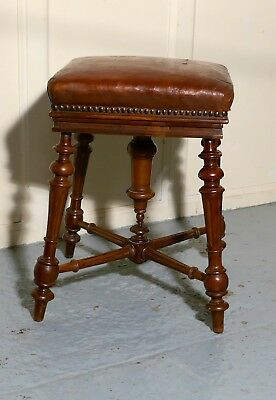 A Rare French Square Walnut and Leather Revolving Piano Stool