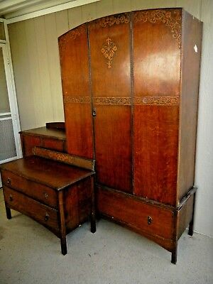 Set of antique bedroom furniture: wardrobe, chest, chest with doors, ornate