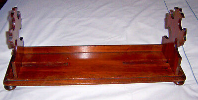 LATE 19th CENTURY MAHOGANY ADJUSTABLE BOOK TROUGH WITH CRUCIFIX STYLE ENDS