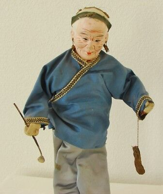 Vintage or older Asian, Chinese, or Japanese old man with pipe; doll or statue