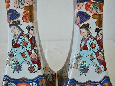 A pair of vintage or older Chinese candle holders, porcelian hand painted gilded