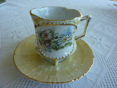 Decorative Small  Tri Footed Cup and Saucer .....Vintage