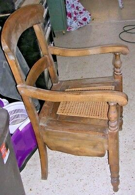 Antique caned commode with chamber pot
