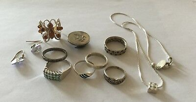 Metal Detecting Finds - 7 Rings, Yellow Metal Earrings, Pendant & Chain + Badge