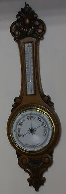 Antique oak aneroid barometer.35 inches.Honey coloured.Not working.