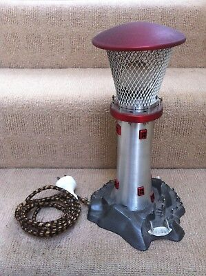 Vintage 1960s anodised lighthouse lamp – good condition. Made in Australia