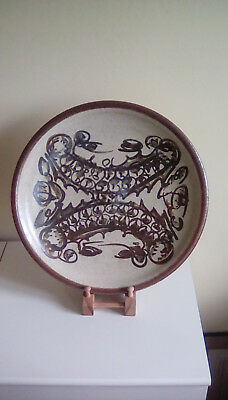 A rare Malcolm Pepper v. large & fine studio pottery charger with iron brushwork