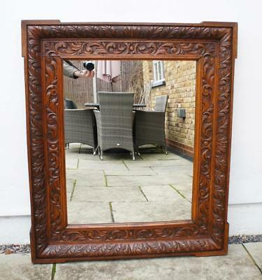 Large Arts & Crafts carved Oak overmantle mirror (105cm x 91cm) dated 1903