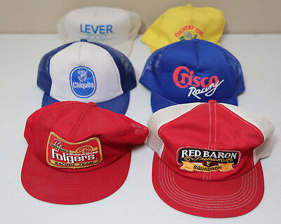 6 Grocery store hats. Folgers. Red Baron. Chiquita. Crisco. Lever. Country Time