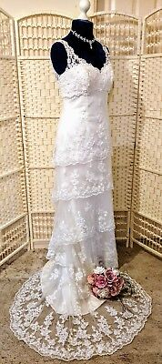 Beautiful lace wedding dress by ALFRED ANGELO BNWOT. Size 12. Stunning tiered...