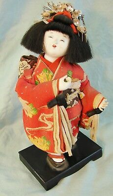 Vintage Japanese Showa period doll with elaborate costume and hair ornamentation
