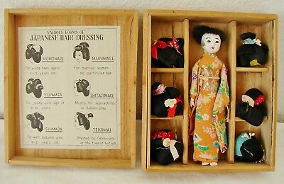 Vintage Japanese Hanako doll with six wigs with descriptions in a wooden box