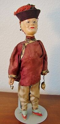 Vintage Asian, Chinese composition character doll, woman with opium pipe and bag