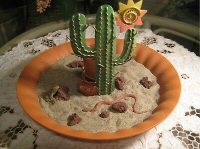 Desert Setting Table Top With Sand And A Votive Candle