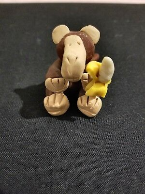 Adorable Hand made Monkey Holding A Banana