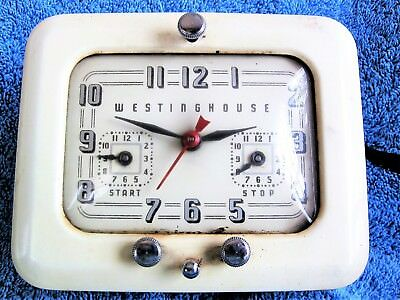 how to set clock on westinghouse oven