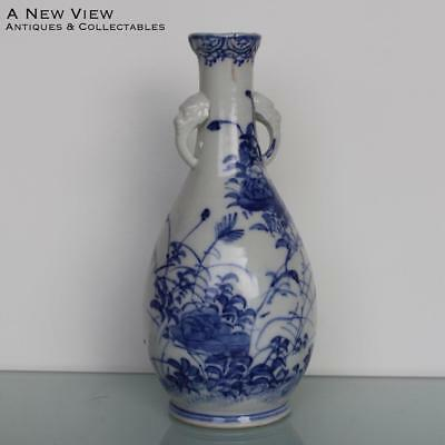 Chinese blue & white floral vase with animal handles.