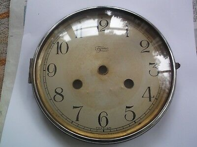 GLASS / RIM/FACE  FROM AN OLD TYMO  MANTLE CLOCK  OUTER 6 1/4 inch diam