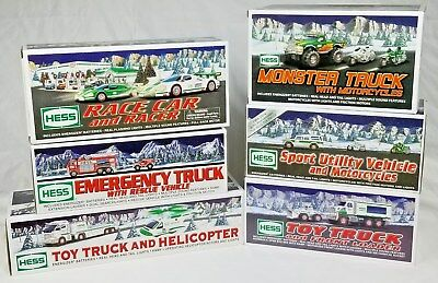 Lot of 6 NEW HESS Toy Trucks/Motorcycles/Monster Truck/Race Car/Helicopter/Dozer
