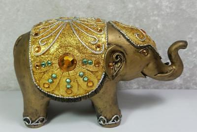 Exotic Elephant Coin Bank Figurine Gold Teal Colors Faux Gems Sculpted Design